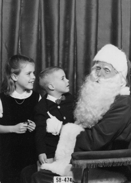 Bambi and brother Jeb with Filene's obviously overworked and weary Santa in Boston, circa 1958.